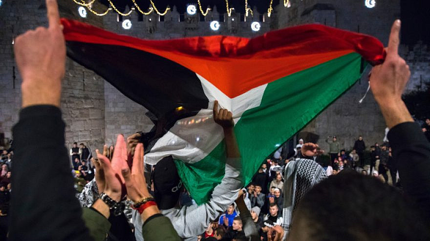 Arabs gather and wave a Palestinian flag at the Damascus Gate in Jerusalem's Old City, during the Muslim month of Ramadan, April 26, 2021. Photo by Olivier Fitoussi/Flash90.