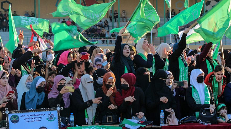 Hamas supporters wave flags during a rally in Gaza City, on May 24, 2021. Photo by Atia Mohammed/Flash90.