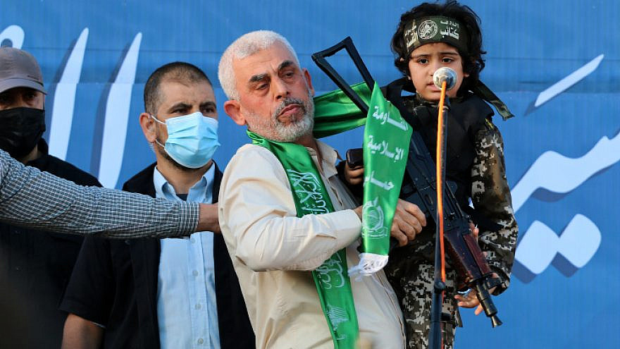 Hamas leader Yahya Sinwar holding a Palestinian child dressed as a Hamas fighter during a rally in Gaza City, on May 24, 2021. Photo by Atia Mohammed/Flash90.