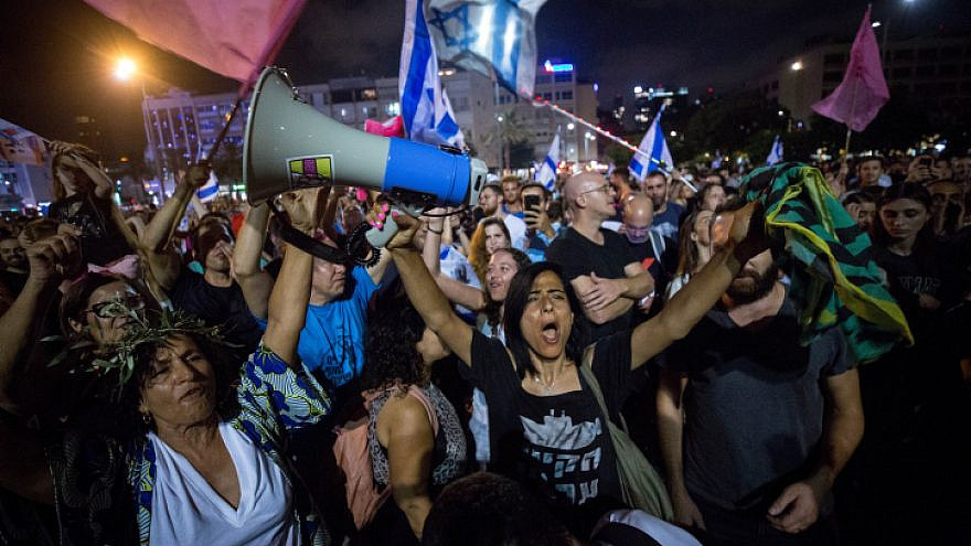 Israelis celebrate the swearing-in of the new government at Rabin Square in Tel Aviv, June 13, 2021. Photo by Miriam Alster/Flash90.
