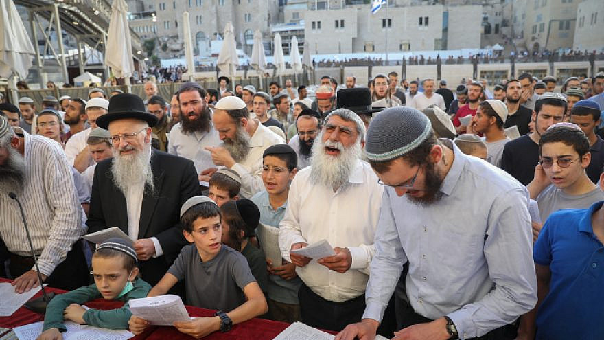 Hundreds of haredi Jews, led by prominent Religious Zionist rabbis, pray at the Western Wall in Jerusalem's Old City that Israel's new government not harm the country's Jewish character, June 13, 2021. Photo by Noam Revkin Fenton/Flash90.