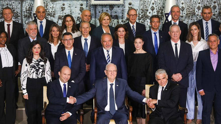 Israeli Prime Minister Naftali Bennett, Foreign Minister Yair Lapid, President Reuven Rivlin and other ministers pose for a group photo of the country's 36th government, at the President's Residence in Jerusalem, June 14, 2021. Photo by Yonatan Sindel/Flash90.
