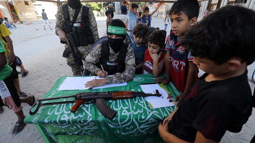 """Hamas fighters register Palestinian children for """"Saif Al-Quds"""" camps in Rafah, in the southern Gaza Strip, on June 14, 2021. Photo by Abed Rahim Khatib/Flash90."""
