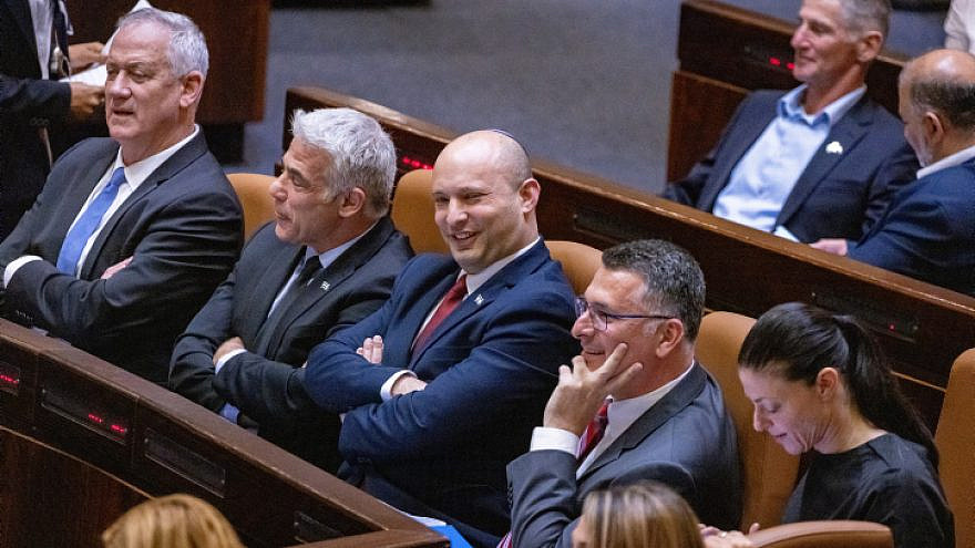 Israeli Foreign Affairs Minister Yair Lapid with Prime Minister Naftali Bennet (center) at the Knesset in Jerusalem on June 21, 2021. Photo by Olivier Fitoussi/Flash90.