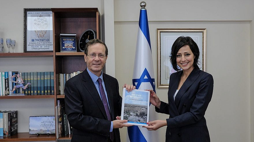 Incoming Jewish Agency shlicha and former Knesset member Gadeer Kamal-Mreeh with chairman of the Jewish Agency and Israel's President-elect Isaac Herzog. Credit: David Salem, Zug Productions.