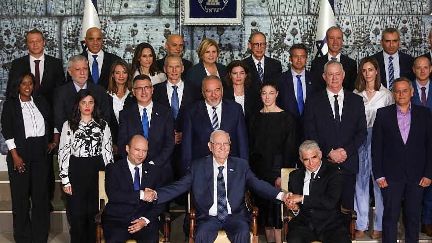 Israeli Prime Minister Naftali Bennett (front row, left), Israeli President Reuven Rivlin, Israeli Foreign Minister Yair Lapid (front row, right) and Israeli ministers pose for a group photo of the newly sworn-in Israeli government, at the President's Residence in Jerusalem on June 14, 2021. Photo by Yonatan Sindel/Flash90.