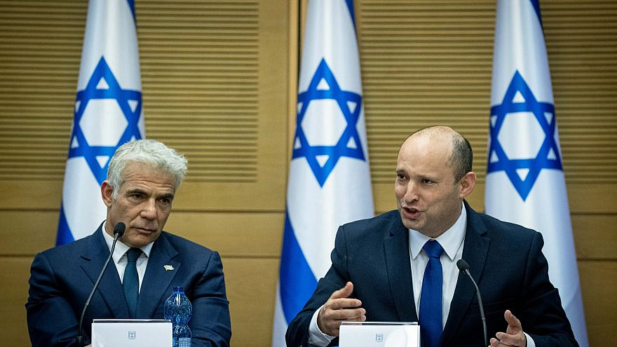 Israeli Prime Minister Naftali Bennett and Israeli Foreign Minister Yair Lapid attend the first government conference, at the Israeli parliament on June 13, 2021. Photo by Yonatan Sindel/Flash90.