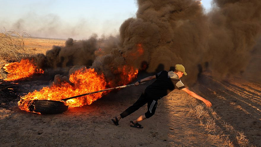 Palestinians in the Gaza Strip burn tires and send incendiary devices across the border with southern Israel, on June 15, 2021. Photo by Abed Rahim Khatib/Flash90.
