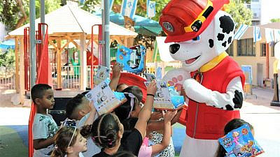 """A """"Paw Patrol"""" character visited children at kindergartens in Jaffa, Israel, signing autographs and handing out toys, June 8, 2021. Photo by Chen Shenhav."""