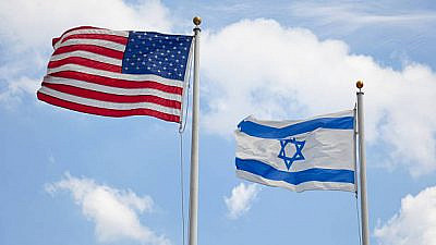 United States & Israeli flags wave together in unison symbolizing concepts such as the American/Israeli bond and Judaism in America. Here are some related images: