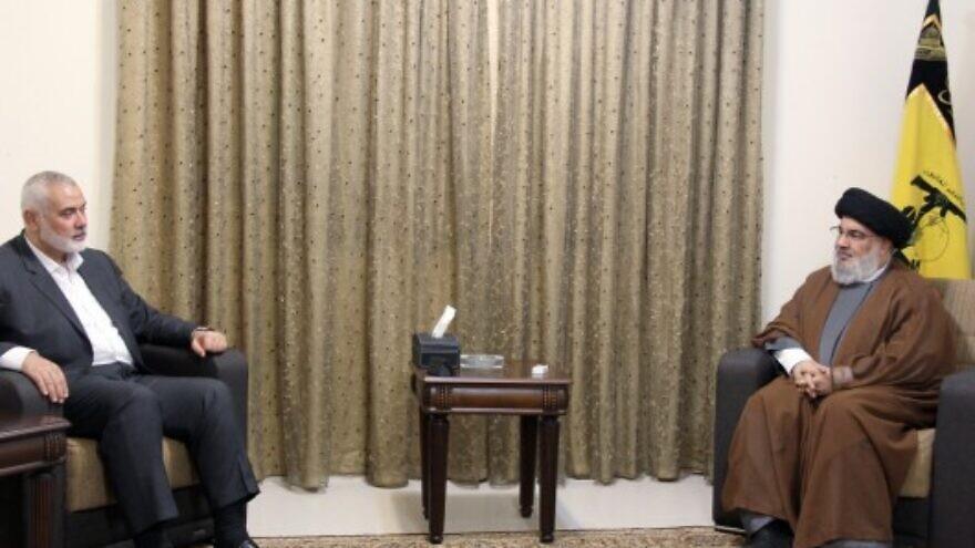 Hamas leader Ismail Haniyeh meets with Hezbollah head Hassan Nasrallah in Beirut, Lebanon on Tuesday (Hezbollah Media Relations, Al-Manar website)