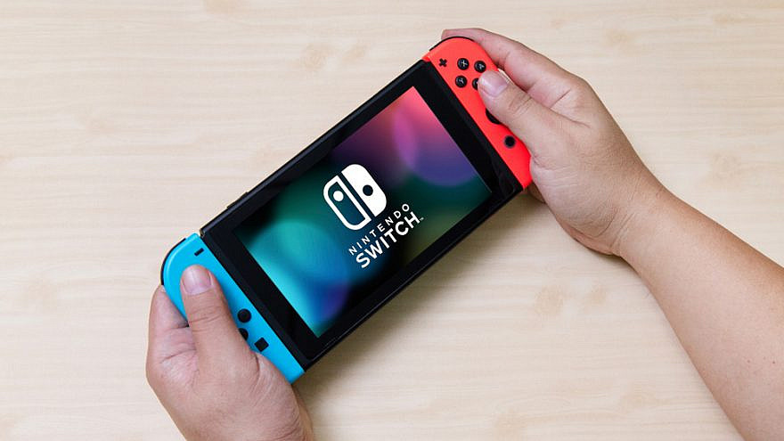 A Nintendo Switch video game console. Credit: Niphon Subsri/Shutterstock.