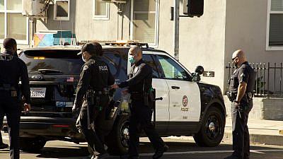 LAPD officers capture a suspect on Hollywood Boulevard. Credit: Elliott Cowand Jr/Shutterstock.