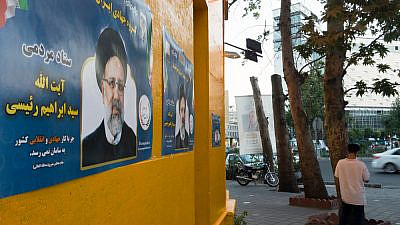 A poster of Ebrahim Raisi, one of the leading candidates in Iran's presidential elections, June 2021. Credit: Farzad Frames/Shutterstock.
