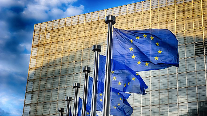 European Union flags in front of the European Commission in Brussels. Credit: Symbiot/Shutterstock.