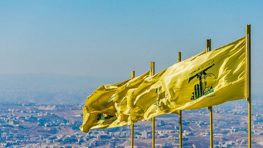 Hezbollah flags flying over southern Lebanon. Credit: John Grummitt/Shutterstock.