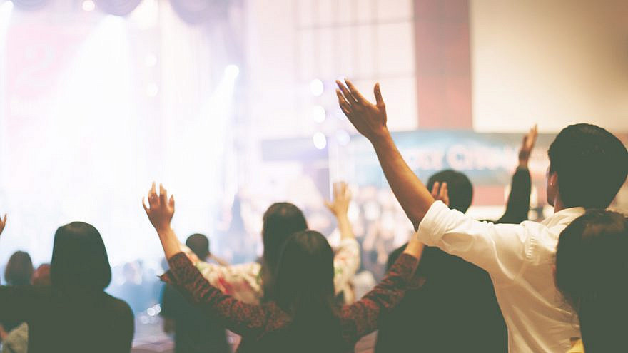 Christian worshippers. Credit: Jantanee Runpranomkorn/Shutterstock.