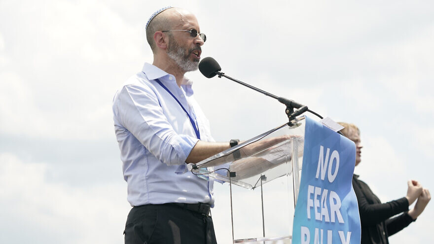 """Business executive Elisha Wiesel, the son of Holocaust survivor and Nobel laureate Elie Wiesel, speaks at the """"No Fear: A Rally in Solidarity With the Jewish People"""" on the National Mall in Washington, D.C., on July 11, 2021. Credit: Chris Kleponis."""