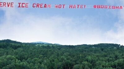 """The Israeli-American Council flew a banner over Ben & Jerry's factory and global headquarters in South Burlington, Vt., reading """"Serve Ice Cream, Not Hate"""" on July 23, 2021. Credit: Israeli-American Council (IAC)."""