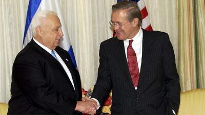 Former U.S. Defense Secretary Donald Rumsfeld with former Israeli Prime Minister Ariel Sharon in October 2002. Credit: Avi Ohayon/GPO.
