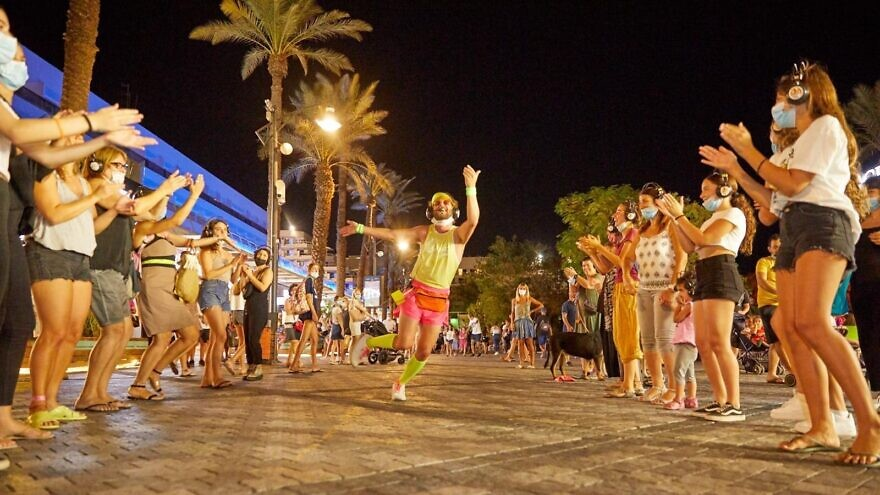 Visitors can take part in a free mobile headphone dance party along the Eilat promenade. Credit: Courtesy/Elad Theater.