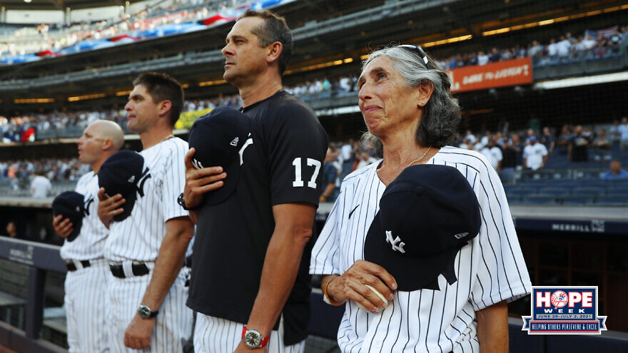Gwen Goldman standing for the national anthem at a New York Yankees game. Source: New York Yankees/Twitter.
