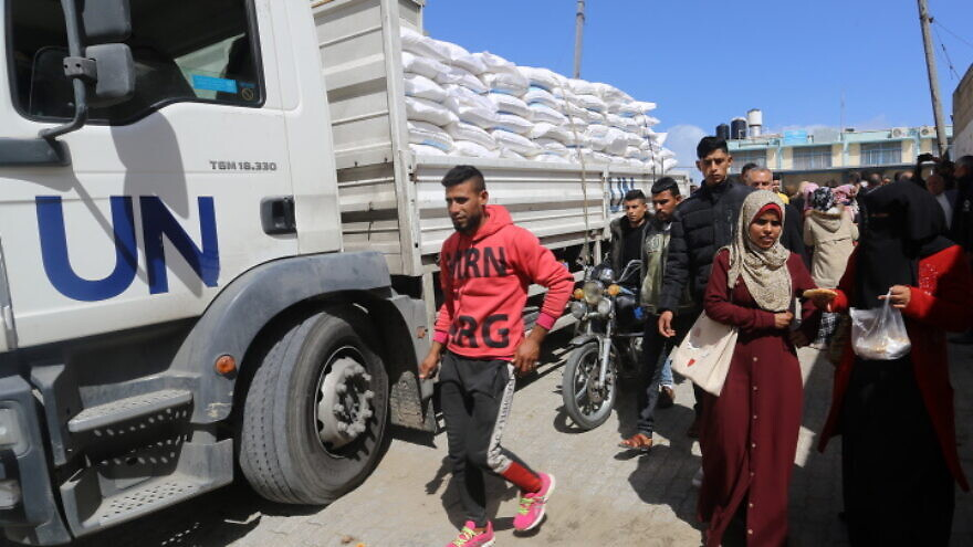 Palestinians come to receive food aid from a UNRWA distribution center in the Khan Younis camp in the southern Gaza Strip, March 7, 2020. Photo by Fadi Fahd/Flash90.
