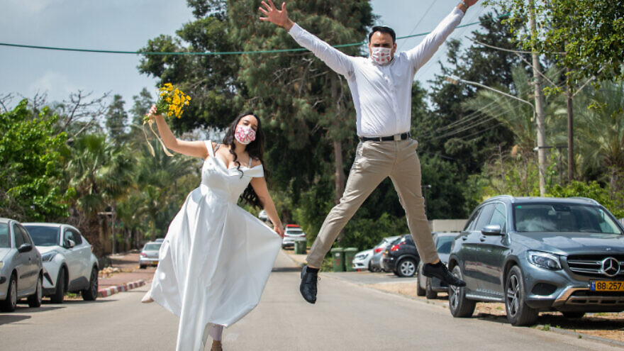 An Israeli couple poses for a picture before their wedding in Moshav Yashresh on April 6, 2020. Photo by Yossi Aloni/Flash90.