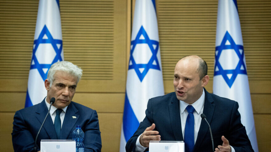 Israeli Prime Minister Naftali Bennett (right) and Foreign Minister Yair Lapid attend a Knesset meeting on June 13, 2021. Photo by Yonatan Sindel/Flash90.
