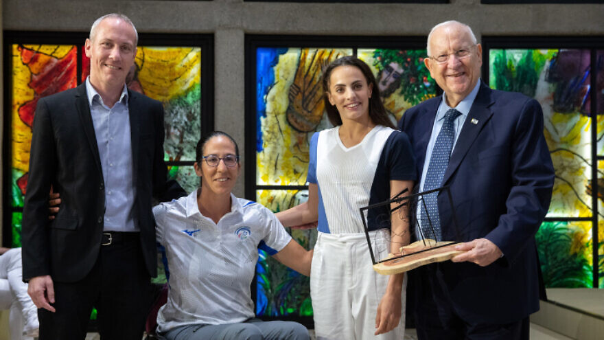 """From left: Israeli Culture and Sports Minister Yehiel """"Hili"""" Tropper, Paralympic rower Moran Samuel, gymnast Linoy Ashram and Israeli President Reuven Rivlin, at the President's Residence in Jerusalem, June 23, 2021. Photo by Olivier Fitoussi/Flash90."""