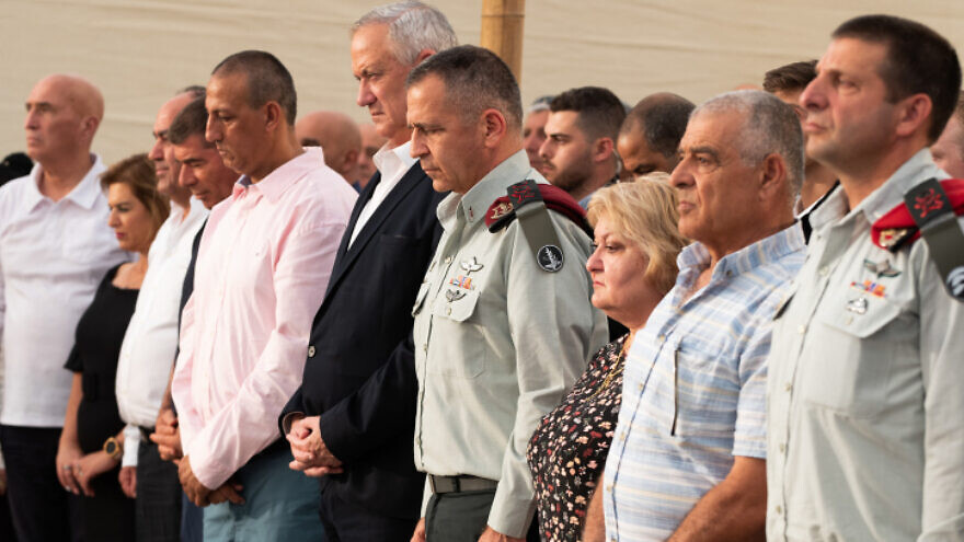 Israeli Defense Minister Benny Gantz (fifth from right) and IDF Chief of Staff Lt. Gen. Aviv Kochavi (fourth from right) at the inauguration ceremony for a new monument in memory of fallen soldiers of the South Lebanon Army (SLA), in Metula, northern Israel, July 4, 2021. Photo by Basel Awidat/Flash90.