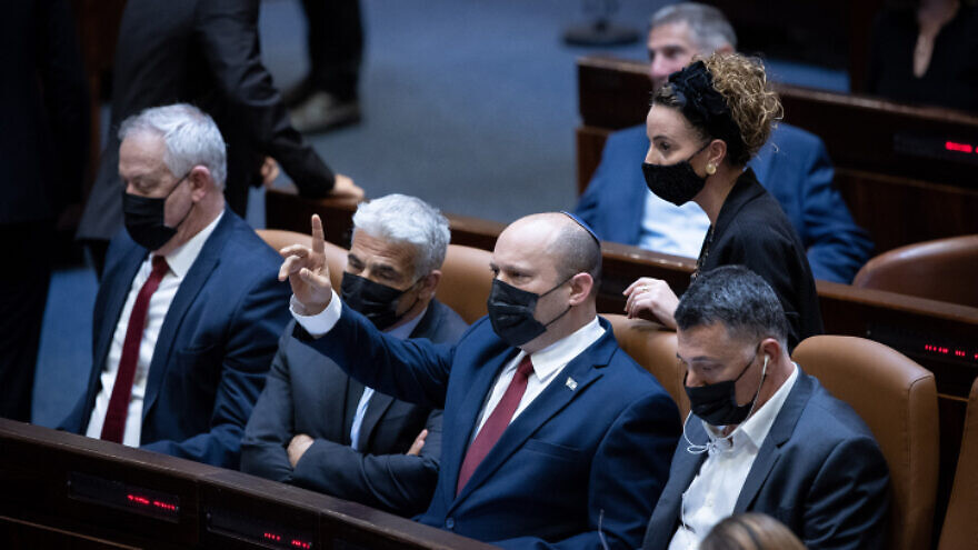 """(L-R) Israeli minister of Defense Benny Gantz, minister of Foreign Affairs Yair Lapid, Prime Minister Naftali Bennett and Minister of Justice Gideon Saar during a discussion on the """"family reunification law"""", during a plenum session in the assembly hall of the Israeli parliament, in Jerusalem, on July 6, 2021. Photo by Yonatan Sindel/Flash90"""