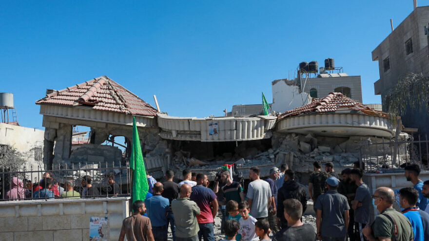 Palestinians stand near the ruins of the house of accused terrorist Muntasir Shalabi in the village of Turmus Aya, northeast of Ramallah, after it was demolished by the Israeli army, July 8, 2021. Photo by Flash90.