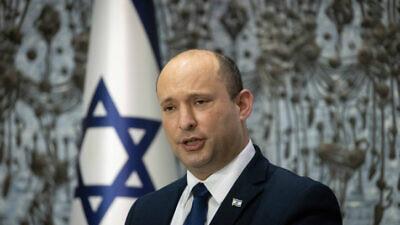 Israeli prime minister Naftali Bennett speaks at a ceremony on July 21, 2021. Photo by Yonatan Sindel/Flash90
