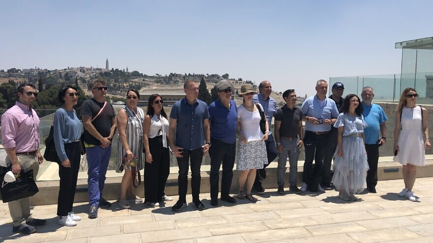 Ambassadors from several nations pose at the Aish HaTorah Center in the Old City of Jerusalem overlooking the Western Wall. Photo by Josh Hasten.