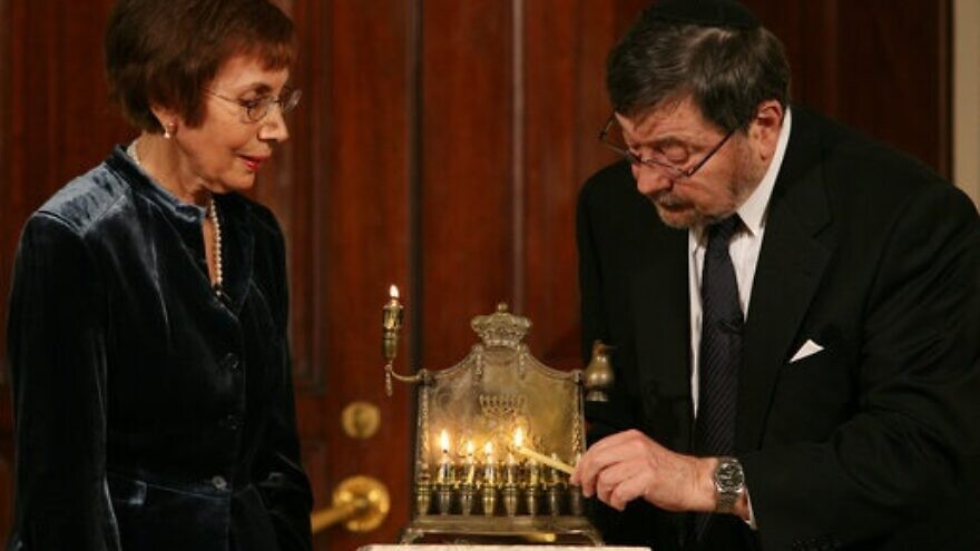 A menorah belonging to the great-grandfather of Daniel Pearl is lit by Judea and Ruth Pearl, his parents, at a Hanukkah celebration on Dec. 10, 2007, in the Grand Foyer of the White House in Washington, D.C. Credit: White House Photo by Joyce N. Boghosian.