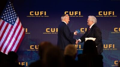 Malcolm Hoenlein, vice chairman of the Conference of Presidents of Major American Jewish Organizations, shakes hands with CUFI founder and president Pastor John Hagee, July 2021. Credit: CUFI.