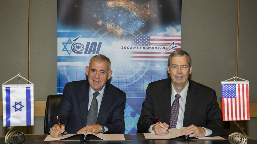 Boaz Levy (left), president and CEO of Israel Aerospace Industries (IAI) with Tim Cahill, senior vice president of global business development at Lockheed Martin. Credit: IAI.