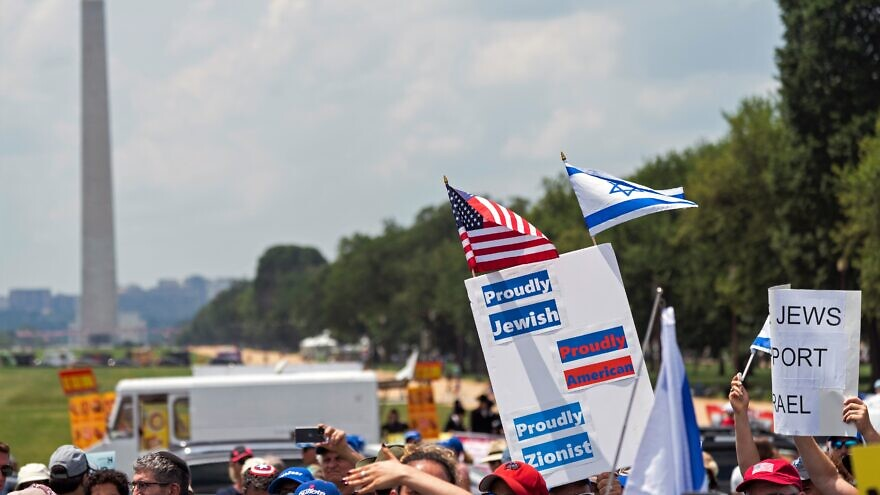 """Signs at the """"No Fear: A Rally in Solidarity With the Jewish People"""" on the National Mall in Washington, D.C., on July 11, 2021. Credit: Chris Kleponis."""