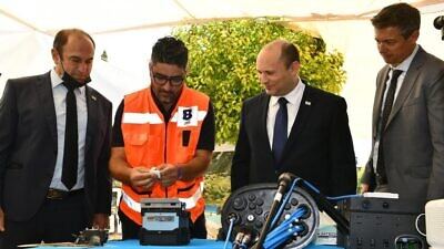 Israeli Prime Minister Naftali Bennett (second from right) and Communications Minister Yoaz Hendel (far right) dedicate the fiber-optic connection in Ma'alot-Tarshiha, July 20, 2021. Credit: Haim Zach/GPO.
