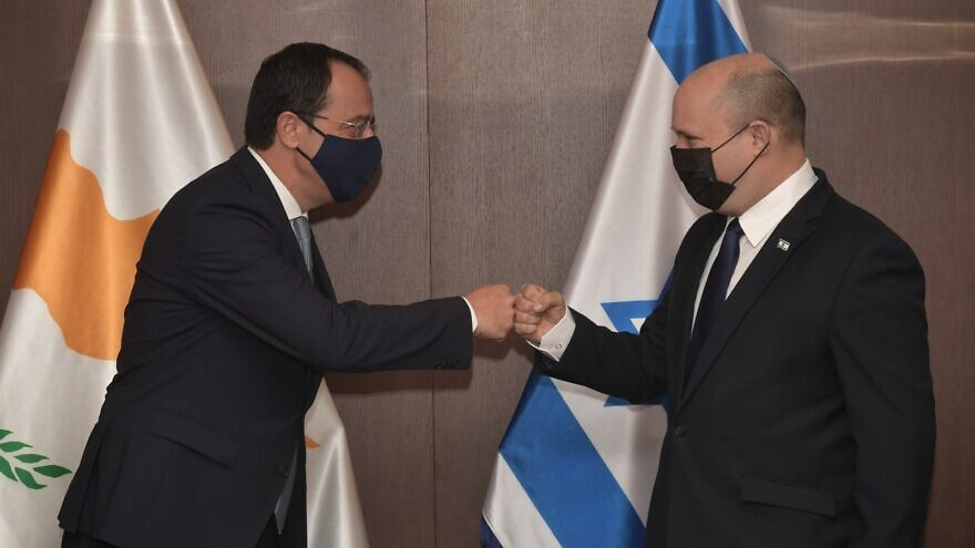 Israeli Prime Minister Naftali Bennett greets Cypriot Foreign Minister Nikos Christodoulides in Jerusalem on July 27, 2021. Photo by Koby Gideon/GPO.