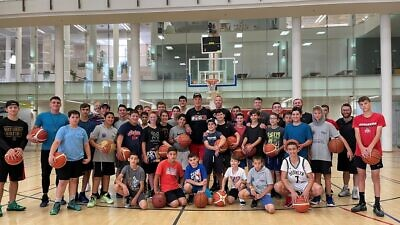 NBA Hall of Famer Rick Barry talks with kids at a basketball summer camp held at the Jerusalem International YMCA on July 8, 2021. Source: Rick Barry/Twitter.