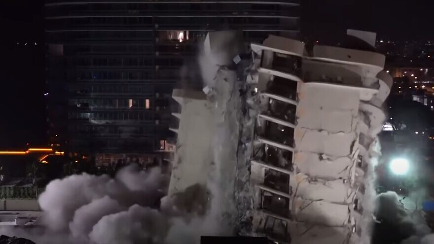 Demolition crews set off explosives to bring down the remaining portion of a collapsed condominium in Surfside, Fla., on July 4, 2021. Source: YouTube.