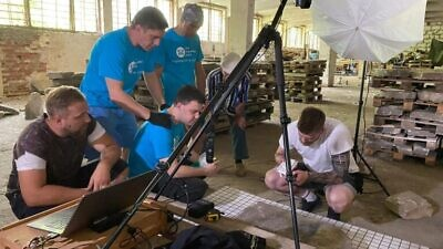 The team cataloging Jewish gravestones discovered in the Eastern European city of Brest. Credit: The Together Plan/Israel Newsstand.
