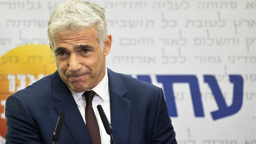 Israeli Foreign Minister Yair Lapid speaks during a Yesh Atid Party meeting at the Knesset on July 26, 2021. Photo by Yonatan Sindel/Flash90.