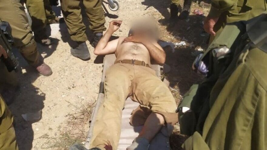 A terrorist who attempted to attack Israeli soldiers near the settlement of Yitzhar, in Samaria, lies with a gunshot wound to his ankle, July 14, 2021. Source: Yitzhar's Spokesperson's Office.