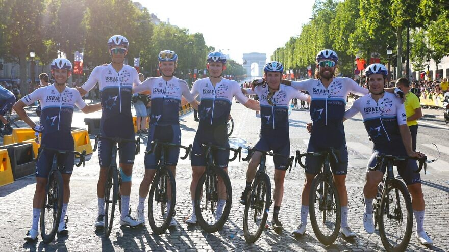 Cyclists with Team Israel Start-Up Nation posing on the Champs-Élysées, July 2021. Credit: Courtesy.