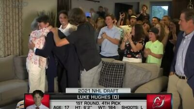Luke Hughes celebrates with his family after being selected in the first round of the NHL draft. Source: Screenshot.