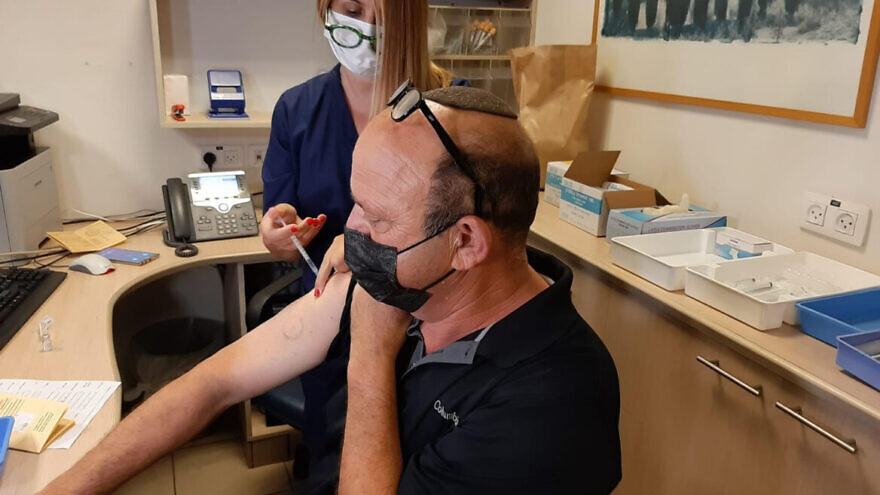 A patient with a heart condition receives a booster shot of the Pfizer COVID-19 vaccine. Credit: Sheba Medical Center.