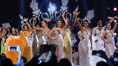 Miss Universe contestants walk on stage during the Miss Universe 2018 preliminary round. Credit: Shutterstock.